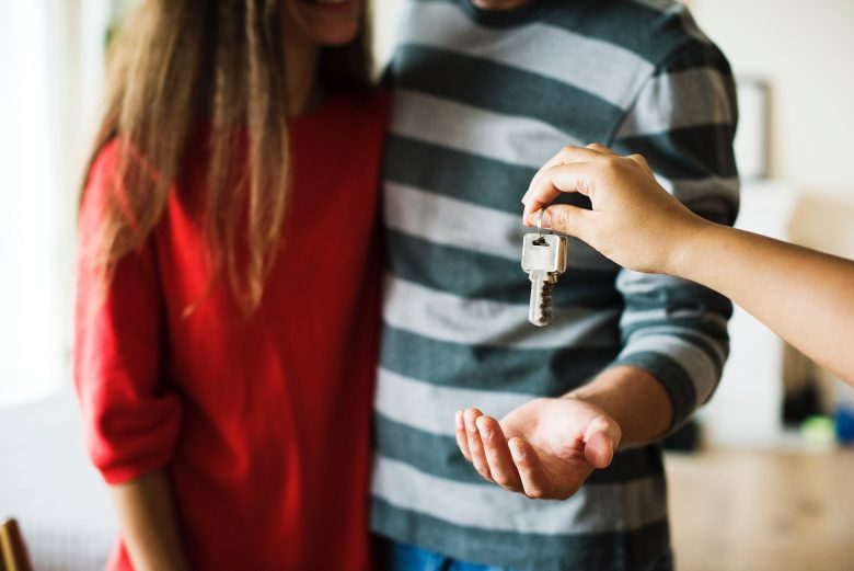 couple with home and keys