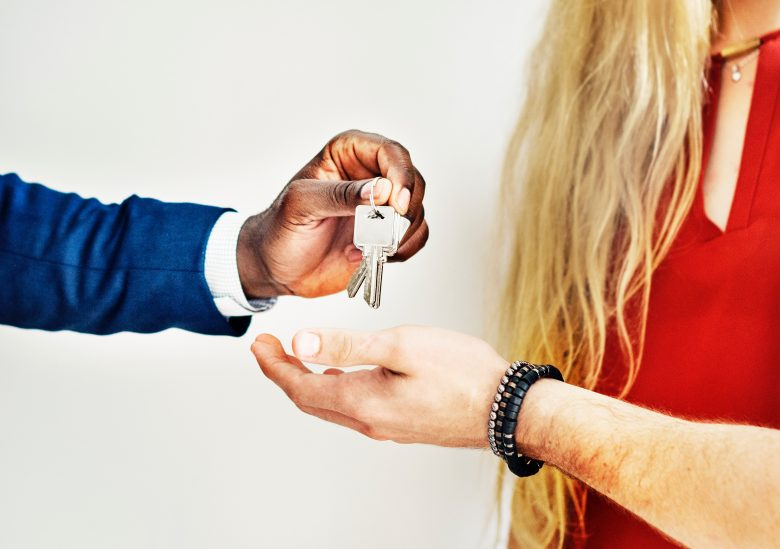 guy handing girl keys