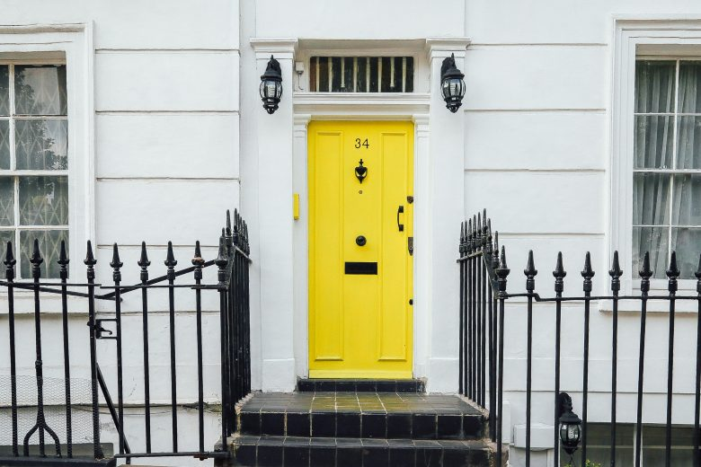 yellow front door of house